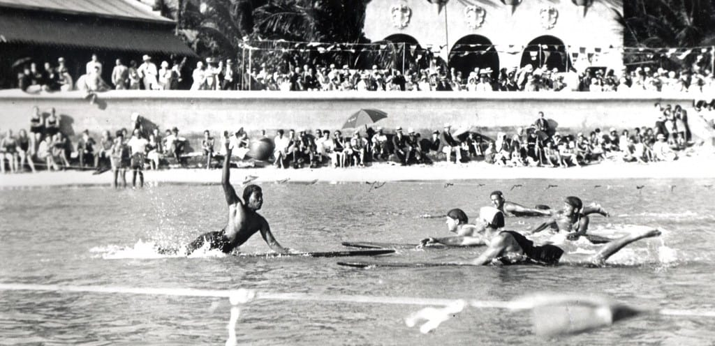 Surfboard Water Polo in front of the old Outrigger and Royal Hawaiian Hotel, circa 1934-35.