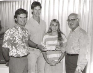 Junior kayak coach Billy , left, was on hand when Walter Guild, chairman of the Steinlager Hawaiian Canoe & Kayak Chamionships, presented a check for $1,000 to ODKF Board chairman Msgr. Charles Kekumano in 1988. The check was made in the names of the winning celebrity crews during the HCKC races. Funds were earmarked for junior kayakers participating at the national o9r international level. Also present was Olympic kayaker Traci Phillips who received financial assistance from the ODKF.