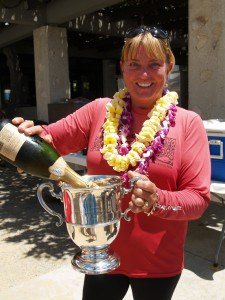 Tiare pours champagne for the winners of the Dad Center Race