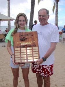 Swim Committee Chair Dennis Blake presents the Castle Swim Trophy to 2004 winner Kristi Torkildson.