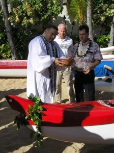 Kawika Grant, center, joins Kahu and OCC General Manager Bill Comstock at a canoe blessing on Christmas Day 2005.