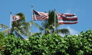 OCC, American and Hawaiian flags fly over the Outrigger Canoe Club.