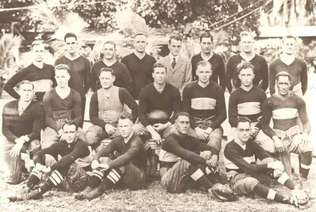 OCC's Championship 1920 Football TeamFront row: Bill Hollinger, Tom Searle, J. D. Kaupiko, W. Thompson. Middle Row: A. Gall, D. McLean, L. J. Hart, P. Withington, coach-captain, Gilbert Colterjohn, J. Hiorth, David Kahananmoku. Back row: E. Gall, C. Campbell, W. Brant, W. Paty, F. Bailey, manager, E. Andrews, W. Anderson, Joe Stickney.